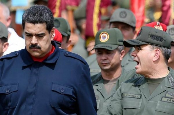 Nicolás Maduro walks with Defense Minister Vladimir Padrino López during a military parade in Caracas in December 2015. JUAN BARRETO AFP/Getty Images\