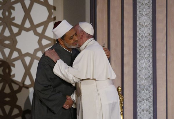 Pope Francis embraces Sheik Ahmad el-Tayeb, grand imam of Al-Azhar University, at a conference on international peace in Cairo April 28, 2017. (CNS/Paul Haring)