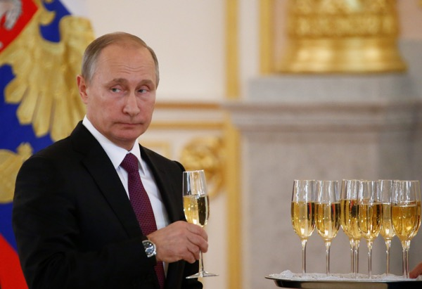Russian President Vladimir Putin holds a glass of champaign. Donald Trump's shock victory in the presidential election T sent champagne corks flying around Moscow where state media and pro-Kremlin politicians were confidently predicting a dramatic turnaround in Russian-U.S. relations.