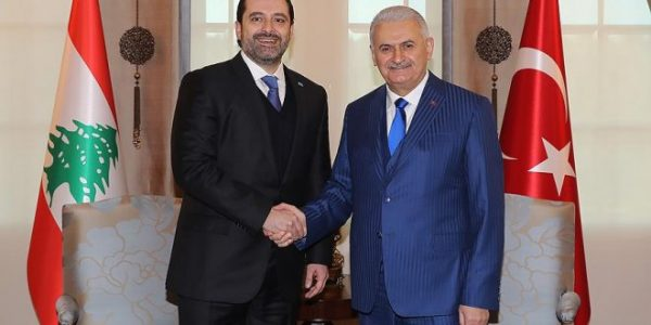 Turkish Prime Minister Binali Yildirim (R) is shown with  visiting Lebanese Prime Minister Saad al-Hariri in Ankara