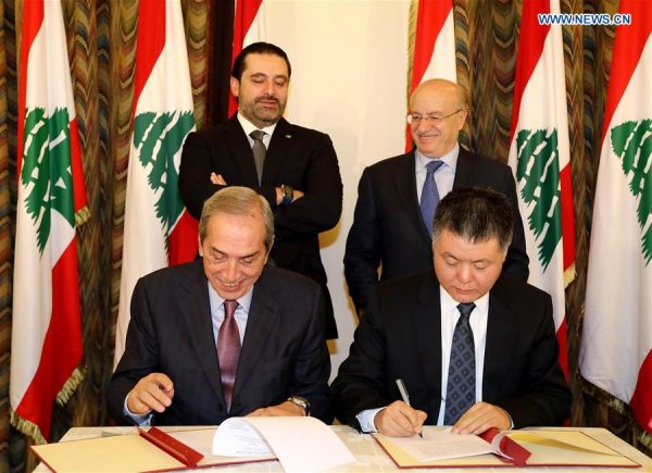 Chinese Ambassador to Lebanon Wang Kejian (R, Front) and Lebanese President of the Council for Development and Reconstruction Nabil El-Jisr (L, Front) sign a project deal in Beirut, Lebanon, on Jan. 9, 2018. The launching ceremony of the Chinese government's funding project to build and equip a new Lebanese National Conservatory of Music was held here on Tuesday. (Xinhua/Dalati & Nohra)