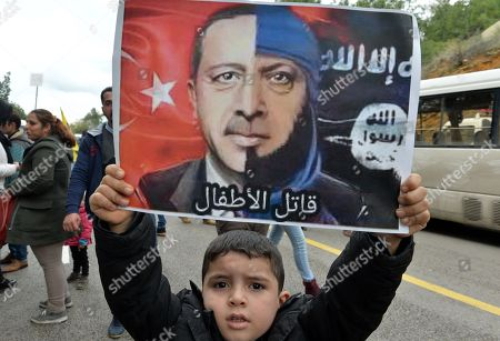 Kurds living in Lebanon    protest against  Turkey's ongoing military operation in northern Syria's Kurdish-controlled Afrin region.  Poster of Erdogan reads : Killer of children