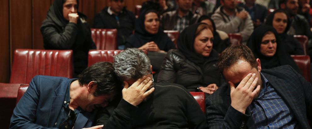 """Iranian Tanker Company, in Tehran, Iran, Sunday, Jan. 14, 2018. The burning Iranian tanker listing for days off the coast of China after a collision with another vessel sank Sunday, with an Iranian official saying there was """"no hope"""" of survival for the 29 missing sailors onboard. (AP Photo/Vahid Salemi)"""