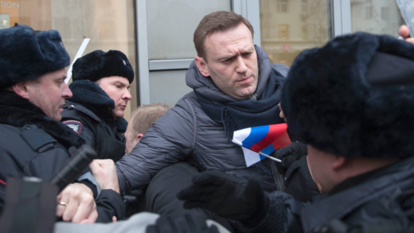 Russian police have detained opposition leader Alexei Navalny in Moscow moments after he appeared at a rally to urge voters to boycott what he said would be a rigged presidential election on March 18.