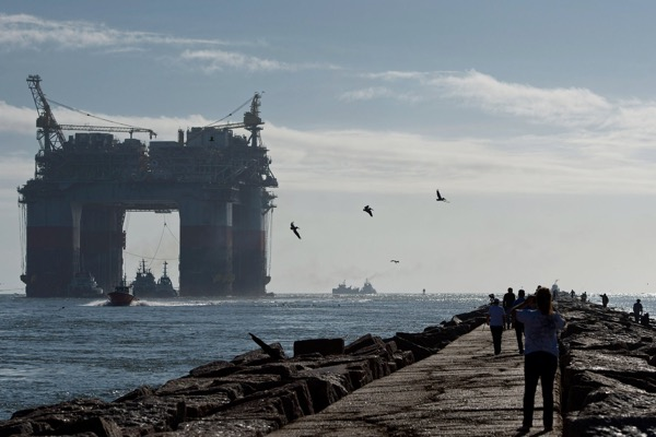 Tug boats pulled a Chevron drilling platform toward the Gulf of Mexico in 2013. The Trump administration said Thursday it would open most of the country's offshore waters to oil and gas drilling. Credit Eddie Seal/Bloomberg, via Getty Images