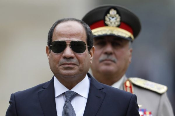 Egyptian President Abdel-Fattah el-Sissi attends a military ceremony in the courtyard at the Hotel des Invalides in Paris, France. On Wednesday, Jan. 31, 2018, a clearly furious el-Sissi gave a thinly veiled but stern warning to opposition politicians calling for a boycott of presidential elections in March, saying he would die first before allowing anyone to mess with the country's security. El-Sissi spoke a day after a coalition of opposition parties and public figures described the vote as a farce. (Charles Platiau, Pool via AP, File)
