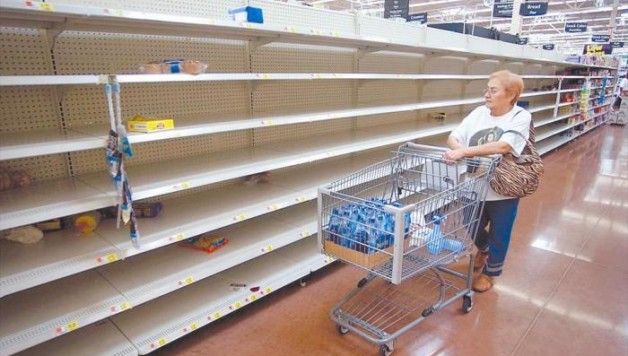 Empty   shelves are pictured at a   supermarket in Caracas, Venezuela,  Venezuelan supermarkets are increasingly being targeted by looters, as swollen lines and prolonged food shortages spark frustration in the OPEC nation struggling with an economic crisis.