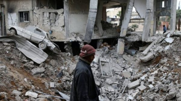 Eastern Ghouta is under constant aerial bombardment (file picture) . A chlorine gas attack has been carried out on a besieged rebel-held enclave on the outskirts of the Syrian capital Damascus