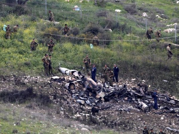Israeli security forces examine the remains of an F-16 Israeli war plane near the Israeli village of Harduf, Israel February 10, 2018. REUTERS/Ronen Zvulun