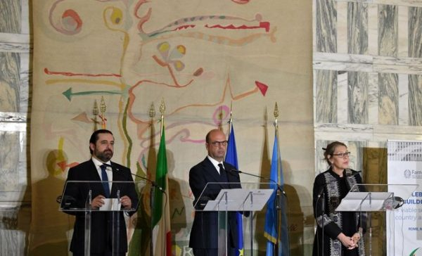 Italian Foreign Minister Angelino Alfano (C) stands along side Lebanese Prime Minister Saad Hariri (L) and UN Special Coordinator for Lebanon Pernille Dahler Kardel, during a joint press conference on the support pledged to the Lebanese security forces, Farnesina palace, in Rome on Mar15, 2018. (AFP)
