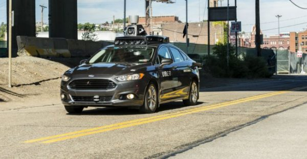 Angelo Merendino / AFP | In this file photo taken on September 13, 2016 a pilot model of an Uber self-driving car travels in Pittsburgh, Pennsylvania.
