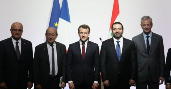 Ludovic Marin, AFP | (L-R) Lebanese politician Ali Hassan Khalil, French Foreign Affairs Minister Jean-Yves Le Drian, French President Emmanuel Macron, Lebanese Prime Minister Saad Hariri and French Economy Minister Bruno Le Maire.