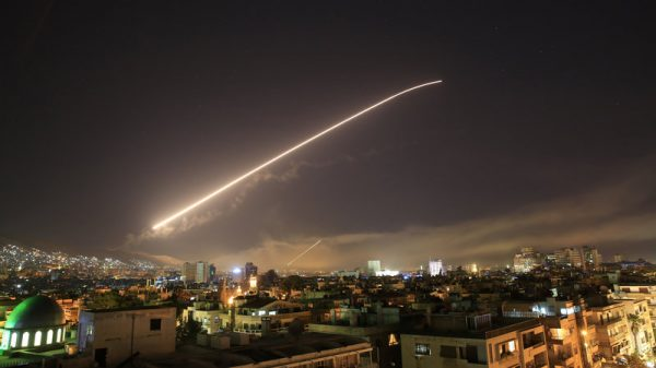The Damascus sky lights up with missile fire as a U.S.-led coalition launches an attack early Saturday, targeting different parts of the Syrian capital. Hassan Ammar/AP