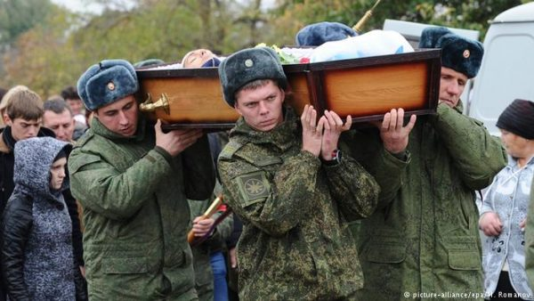 Funeral of Russian soldier Vadim Kostenko : 19-year-old's open casket was carried through the streets of his home town by fellow soldiers to its final resting place. No priest presided over the ceremony, reports claimed, because the boy's death in Syria, was allegedly a suicide - a sin in Orthodox eyes