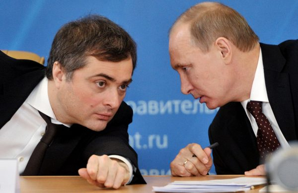 Russia's Prime Minister Vladimir Putin confers with his aide  Vladislav Surkov during a meeting on the modernization of the secondary education in the Urals city of Kurgan, on February 13, 2012.