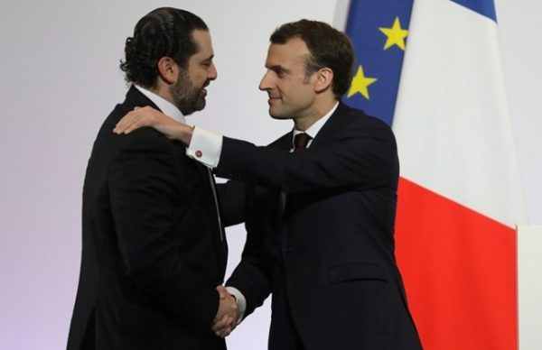 Lebanese Prime Minister Saad Hariri, left, shakes hands with French President Emmanuel Macron as they attend the international CEDRE conference in Paris Friday, April 6, 2018.International donors are set to give the green light to a $10-billion investment plan for Lebanon at the conference in Paris, hoping to stave off an economic crisis. Lebanon's economic growth has plummeted due to repeated political crises, compounded by the Syrian war which has sent a million refugees across the border -- e