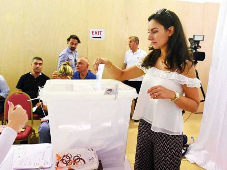 A Lebanese expat casts her vote for the Lebanese elections at the premises of Lebanese embassy in Abu Dhabi.