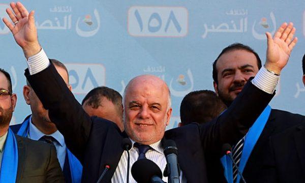 The Iraqi prime minister, Haider al-Abadi, speaks at a campaign rally in Baghdad. Photograph: Hadi Mizban/AP