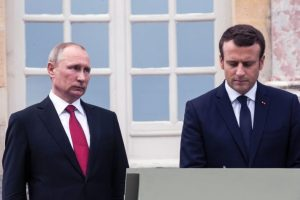 French President Emmanuel Macron (R) and Russian President Vladimir Putin sign the golden book after a visit of an exhibition about Russian emperor Peter the Great at the Grand Trianon following their meeting at the Versailles Palace, near Paris, on May 29, 2017.  Macron hosts Russian counterpart Vladimir Putin in their first meeting since he came to office with differences on Ukraine and Syria clearly visible. / AFP PHOTO / POOL / Etienne LAURENT        (Photo credit should read ETIENNE LAURENT/AFP/Getty Images)