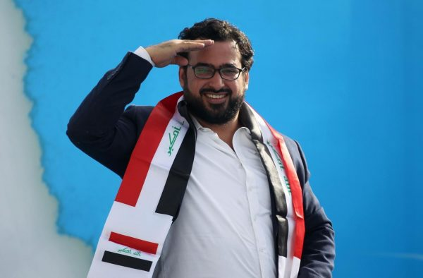"Muntazer al-Zaidi, an Iraqi journalist famous for throwing shoes at former US president George W. Bush in 2008, attends a rally in Baghdad on May 4, 2018 for the ""Marching Towards Reform"" alliance between Shiite leader Moqtada al-Sadr and the communist party, ahead of the May 12 parliamentary elections. AHMAD AL-RUBAYE/AFP/GETTY IMAGES"