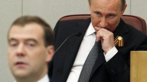 Dmitry Medvedev  is shown at the Russian Parliament with  Vladimir Putin in 2012 when they  swapped jobs .  Putin may do this again  in 2024   when he will no longer be entitled to run for president