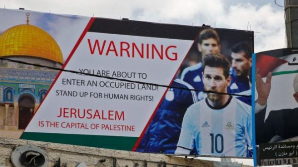 Lionel Messi on a poster in the West Bank protesting against the planned fixture