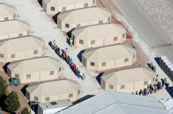 """Immigrant children, many of whom have been separated from their parents under a new """"zero tolerance"""" policy by the Trump administration, are being housed in tents next to the Mexican border in Tornillo, Texas, U.S. June 18, 2018. REUTERS/Mike Blake"""
