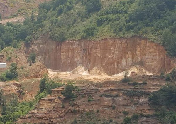 A quarry cuts into an entire hill in the Lebanese mountains at Tarshish (Nelofer Pazira) ( )
