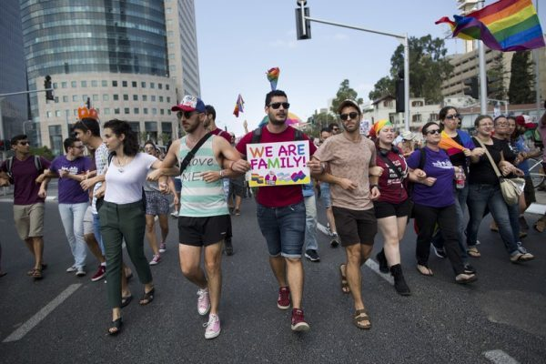 Tens of thousands of Israeli LGBT advocates and their supporters went on strike across the country Sunday, protesting the exclusion of gay men from a recently passed surrogacy law.