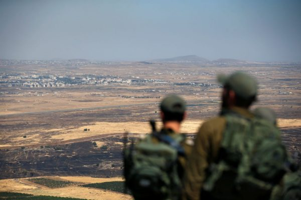 Israeli soldiers this month looking over the Israel-Syria border on the Israeli-occupied Golan Heights. PHOTO: RONEN ZVULUN/REUTERS