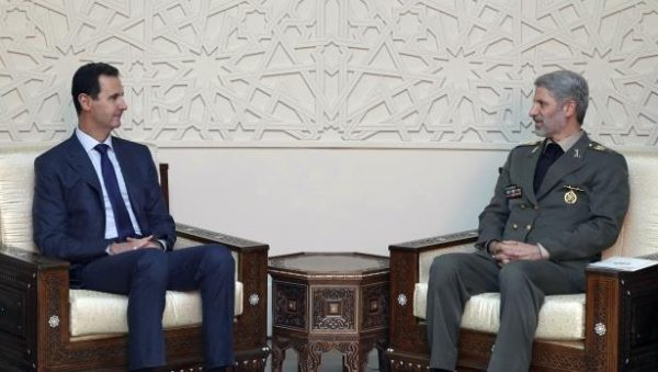 This photo released by the Syrian official news agency SANA, shows Syrian president Bashar Assad, meets with Iran's Defense minister Amir Hatami, in Damascus, Syria, Sunday, Aug. 26, 2018. Iran has provided key support to Assad in the seven-year civil war, sending thousands of military advisers and allied militiamen to bolster his forces. (SANA via AP) Source: http://us.pressfrom.com/news/world/-181054-iran-says-no-third-party-will-limit-its-support-to-syria/