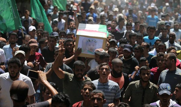 Mourners carry coffin of pregnant Palestinian mother and her toddler killed in Israeli airstrike