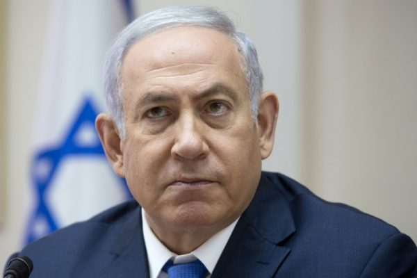 FILE - In this Sunday, July 29, 2018 file photo, Israeli Prime Minister Benjamin Netanyahu attends the weekly cabinet meeting at the Prime Minister's office in Jerusalem. Israel's recent detentions of Jewish-American critics entering the country is shining a spotlight on a growing gulf between the country's hard-line government and the predominantly liberal Jewish community in the U.S. (AP Photo/Sebastian Scheiner, File)