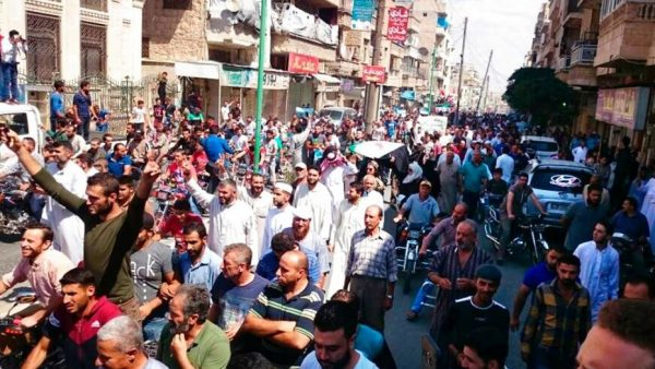 Protesters holding Syrian revolution flags and chanting, in Maaret al-Numan, a town in Idlib province, Syria, Friday, Sept 7, 2018; The Friday rallies came as Presidents of Iran, Turkey and Russia are meeting in Tehran to discuss the war in Syria