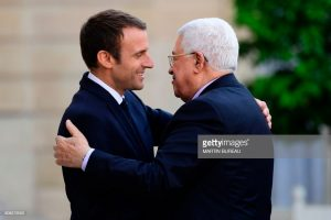 French President Emmanuel Macron (L) greets Palestinian President Mahmoud Abbas prior to their meeting at the Elysee Palace in Paris,  AFP PHOTO / Martin BUREAU        (Photo credit should read MARTIN BUREAU/AFP/Getty Images)