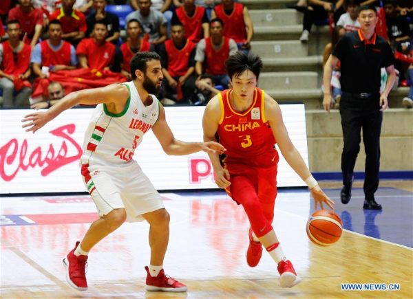 Hu Mingxuan (R) of China vies with Amir Saoud of Lebanon during the FIBA 2019 World Cup Asian Qualifiers 2nd round Group E match between Lebanon and China in Beirut, Lebanon, on Sept.13, 2018. China lost 88-92. (Xinhua/Bilal Jawich)