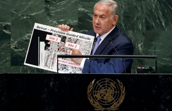 "Holding up aerial photos of the alleged Hezbollah facilities, PM Netanyahu warned Hezbollah : ""Israel knows what you are doing, Israel knows where you are doing it, and Israel will not let you get away with it."""