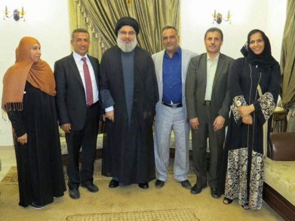 Hezbollah chief Hassan Nasrallah  is shown with several officials of the  Houthi rebels
