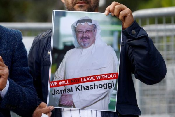 A demonstrator holds picture of Khashoggi during a protest in front of Saudi Arabia's consulate in Istanbul, Turkey.PHOTO: REUTERS