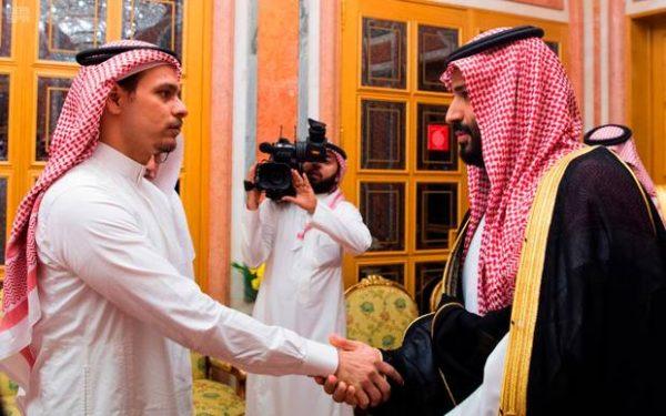 Saudi Crown Prince Mohammed bin Salman, right, shakes hands with Salah Khashoggi, eldest son of slain journalist Jamal Khashoggi, in Riyadh, Saudi Arabia. Photo / AP