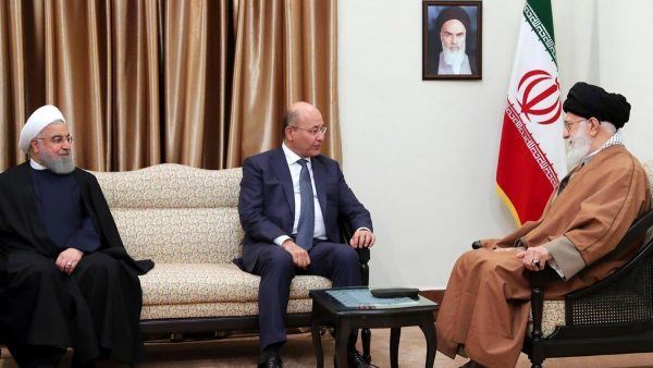 Iraqi President Barham Salih, center, speaks with Iranian Supreme Leader Ayatollah Ali Khamenei, right, as his Iranian counterpart Hassan Rouhani listens during their meeting in Tehran, Iran. Office of the Iranian Supreme Leader via AP