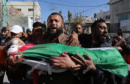 Mourners carry the body of Palestinian boy Ahmed Abu abed, who was died of his wounds which he sustained by Israeli forces during clashes in tents protest where Palestinians demand the right to return to their homeland at the Israel-Gaza border, during his funeral in Khan Younis in the southern Gaza Strip Four year old boy allegedly killed by Israeli troops, Gaza, Palestinian Territories - 12 Dec 2018