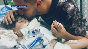 Two-year-old Abdullah Hassan has been on life support at UCSF Benioff Children's Hospital in Oakland for the past month. He is shown with his father Ali Hassan. The family says President Trump's travel ban, which applies to travelers from mostly Muslim majority nations, is keeping the boy's  mother from entering the U.S.