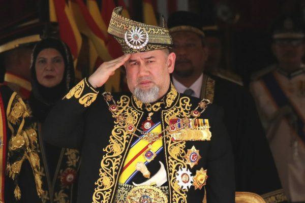 FILE - In this July 17, 2018 file photo, Malaysia King Sultan Muhammad V delivers the opening speech during the opening of the 14th parliament session at the Parliament house in Kuala Lumpur, Malaysia. Muhammad V has abdicated in an unexpected and rare move, after just two years on the throne. The palace said in a statement on Sunday, Jan. 6, 2019, that the sultan has resigned with immediate effect, cutting short his five-year term, without giving any reasons. Muhammad V, ruler of northeast Kelantan state, was installed in December 2016 as one of the country's youngest constitutional monarchs. (AP Photo/Yam G-Jun, File)