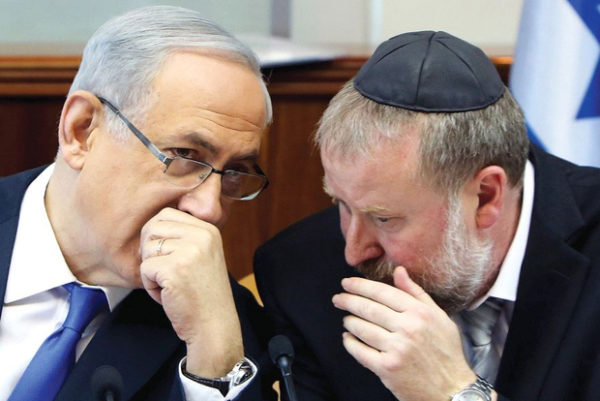 The right-wing tabloid Israel Hayom reported that officials in Netanyahu's Likud party, if not Netanyahu himself (left), were trying to bully Attorney General Mandelblit (right). (Reuters)