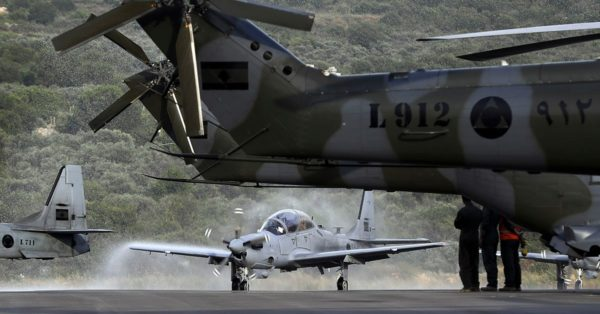 A picture shows an A-29 Super Tucano aircraft being sprayed with water as a welcome ritual during a handover ceremony by the U.S. Lebanon received the second lot of four A-29 Super Tucano in June 2018 in its bid to assist the Lebanese armed forces. (Joseph Eid/AFP/Getty Images)