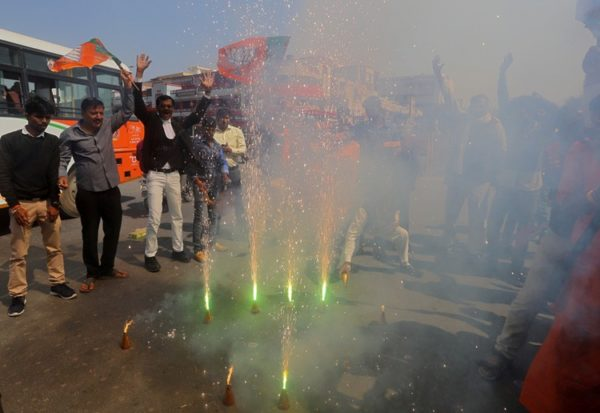 Supporters of India's ruling Bharatiya Janata Party (BJP) light fireworks to celebrate after Indian authorities said their jets conducted airstrikes on militant camps in Pakistani territory, in Prayagraj, India, February 26, 2019. REUTERS/Jitendra Prakash