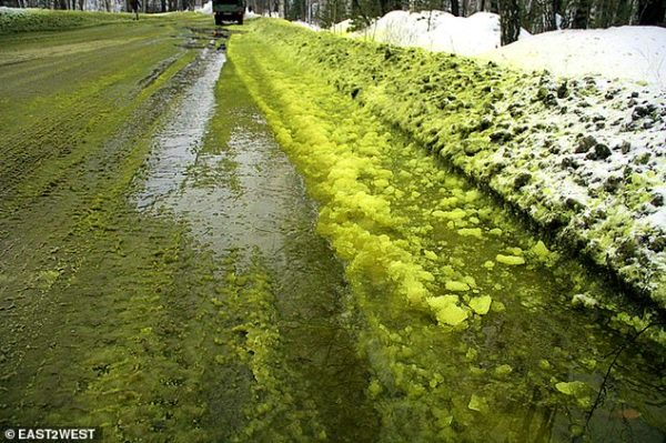Residents in Pervouralsk were horrified when chemicals spilling from a chrome factory turned white snow to an acid green colour