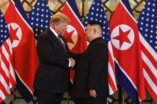 US President Donald Trump (left) shakes hands with North Korea's leader Kim Jong-un before a meeting at the Sofitel Legend Metropole hotel in Hanoi on February 27, 2019.AFP