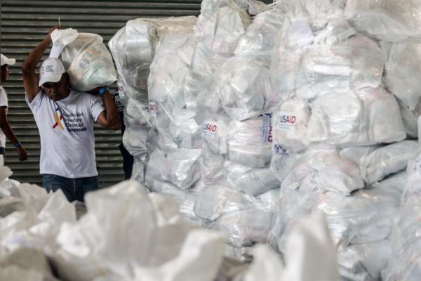 A volunteer sorts U.S. humanitarian aid packages in Cucuta.Photographer: Ivan Valencia/Bloomberg